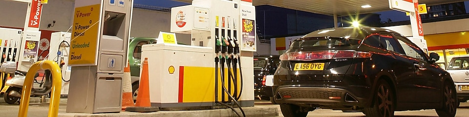 Car waiting to get gas fuelled at Gas station